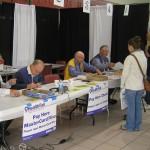 Cashiers assist participants
