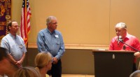 New member, Dale Edwards, sponsored by Tobey Yadon, is inducted into the Fort Collins Lions Club by Ron Lockner.
