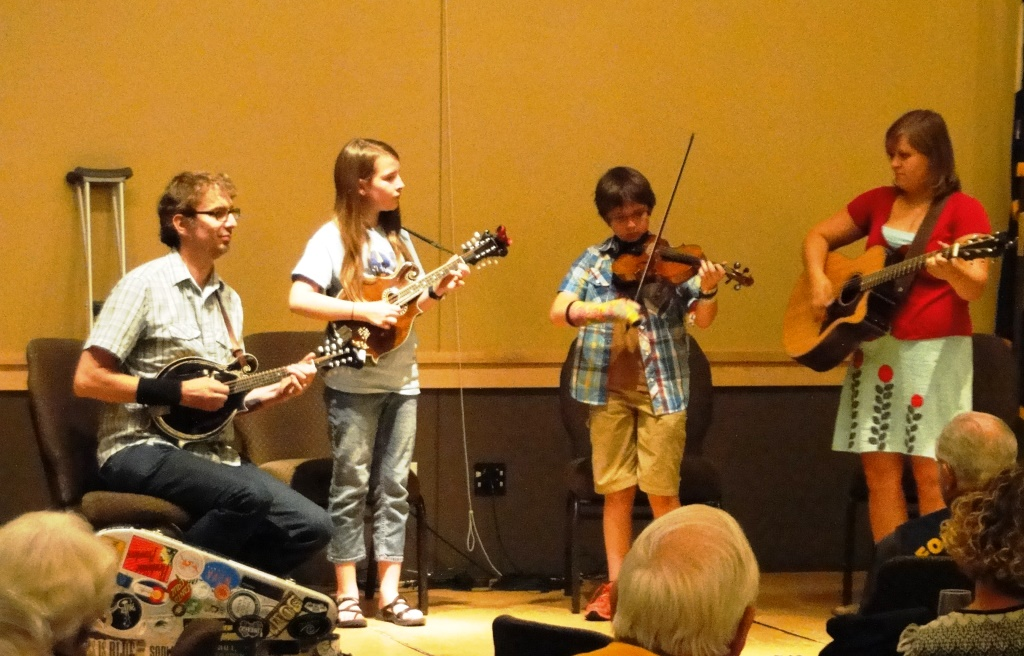 Chad Fisher, instructor, Grace Kuch, mandolin, Sammy Davison, fiddle, and Lydia Demi-Smith, instructor