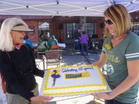 Margaret Spiller and Melody Glinsman showing off the cake
