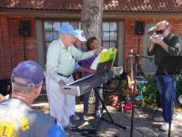 Lions Alan Beatty, Bill Funke, Dan Fahrlander, Kathy provide music