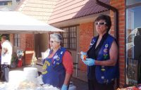 Nancy Walther and Denise Clines helping with the food line